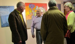 My father, the short white haired chap, enjoying his private view.