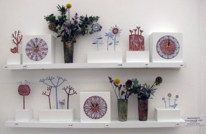 Enamelled clocks, standing figures and vases