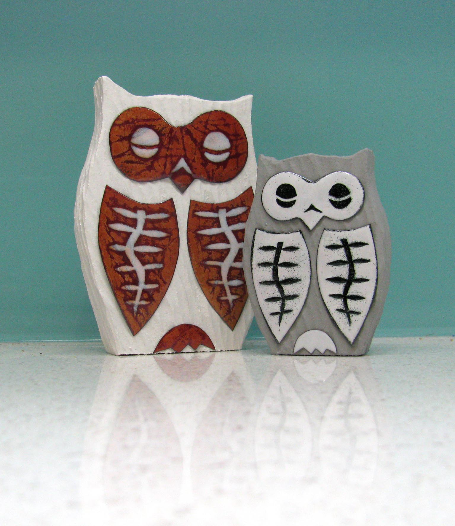 Carved owls with enamel details